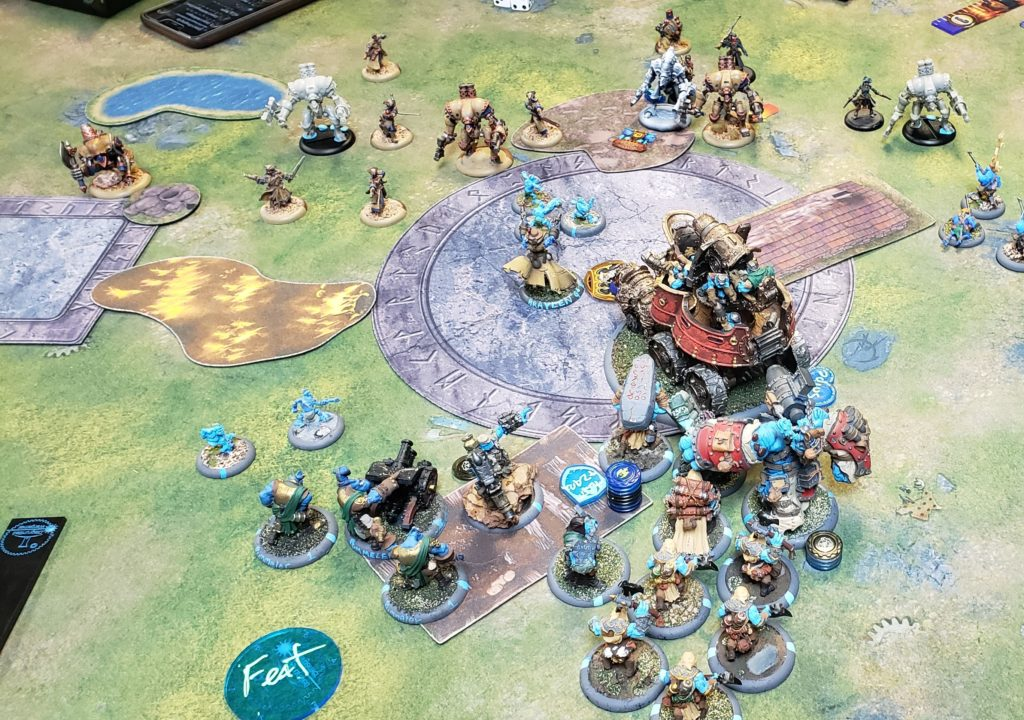 Trollbloods vs Cygnar, War Wagon under Gunnbjorn, and Braylen scoring a flag.